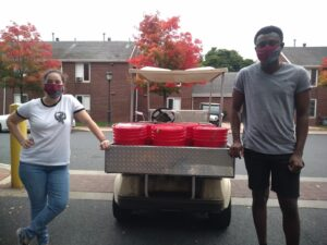 students load compost into golf cart